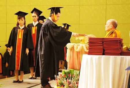 Students receive their certificates from Dr. Phraratsithamunee, assistant to the abbot of Wat Mahathatyuwarat Rangsaritatchawarom Mahaviharn, MD of the International Vipassana Thura (the burden of contemplation) project.