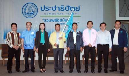 Local Democrat party leaders, led by central region party boss Alongkorn Pholbut (center, with flag), host a public meeting at the Cape Dara Hotel.