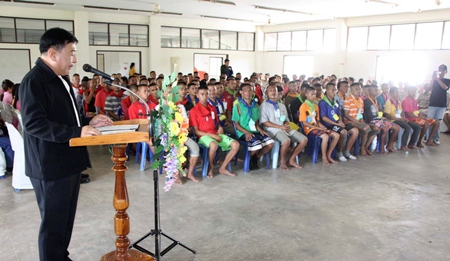 "Deputy Gov. Adisak Thepass presides over the graduation ceremony for inmates at the 10-day ""behavior modification camp"" run by the Royal Thai Navy."