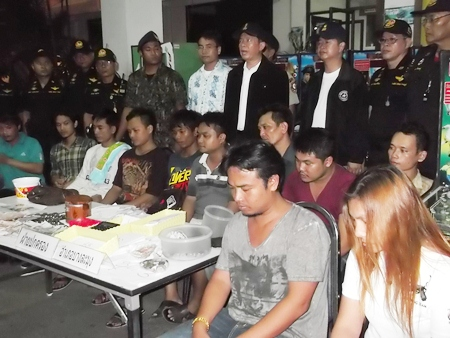Police bring out the 11 suspects rounded up during the May 2 multiple casino raid.