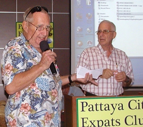 Back by popular demand after a short stint of R & R, 'Hawaii Bob' Sutterfield starts the meeting by conducting the Frugal Freddy drawing of specials at Pattaya's many value & quality restaurants.