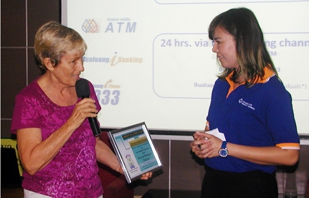 Waraporn Brand-Srinaka, Senior Sales & Marketing Specialist, Foreign Customer Segments provided information about Bangkok Bank products and services available to foreigners. Here she receives a Certificate of Appreciation for the Banks informative presentation.