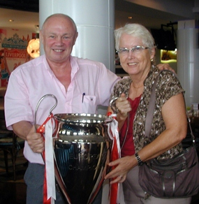 New member Peter Banner, the 'Happy Auctioneer' and member Donna Westendorf pose with a replica of the European Champions Cup, supporting the upcoming Golf Day & Dinners on the 7th and 9th of June, and the Gala Dinners on the 6th & 8th of June. For more information, contact events@legacyoflegends.org.