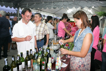 Wine representatives give out samples of wine to loyal customers.