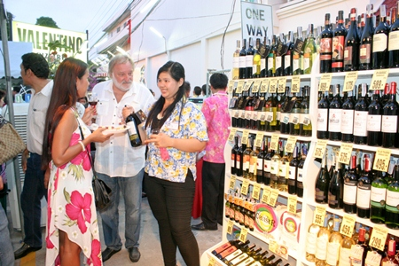 Customers buy wines at special prices to take back home.