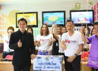 Rattakit Hengtrakul (left), assistant MD of services at Sophon Cable TV Pattaya, along with GM Attasitthi Chuachuchart and staff seal the coupon box in preparation of the big drawing on May 18.