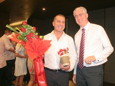 Brendan Daly, general manager of Amari Orchid Pattaya congratulates Miki on his 50th.