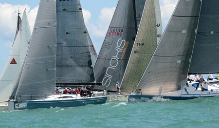 'Foxy Lady' leads the IRC-1 fleet over the start line.