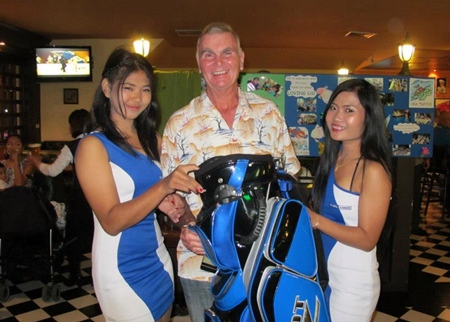 A Flight winner Jeff Wylie (center) collects his prize.