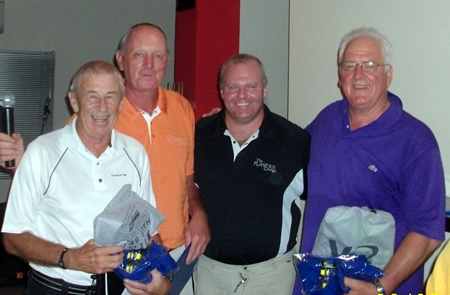 Terry Mangan & Ed Junger collect their prizes from Bob Newell.