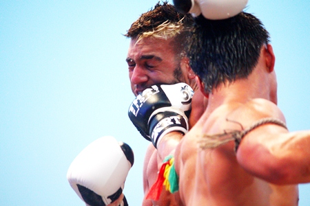 Peemai Jitmuangong lands a punch on Frenchman Yacine Darkrim during the first bout of Thai Fight Extreme at Bali Hai, Friday, April 19.