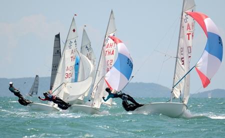 Class winners Sittisart Ponpun and Peerapol Wisaka (right) lead the double-handed monohull dinghy fleet downwind.