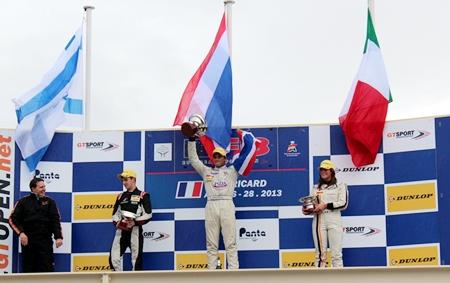 Sandy Stuvik celebrates atop the podium at the Paul Ricard circuit in France, Sunday, April 28.