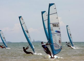 Sailors compete at the 2013 Thailand Windsurfing Championships held at Jomtien Beach, Pattaya.