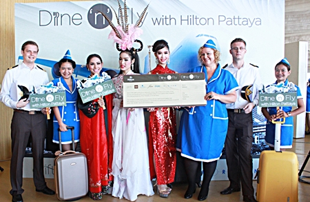 "Peta Ruiter (3rd right), director of business development for Hilton Pattaya, leads her team in announcing this year's Hilton Pattaya ""Dine 'n' Fly"" promotion."
