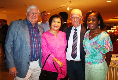 (L to R) David and Siriwan Anderson happily meet up with good friends Richard and Janet Smith.