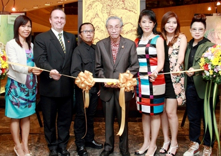"Professor Dr. Prasert Thongcharoen, Consultant at the Siriraj Hospital Faculty of Medicine, presided over the opening ceremony of an art exhibition titled ""In the Nature"" by Nattawut Sophawang at the Amari Watergate Bangkok recently. The proceeds were donated to the Siriraj Foundation. (L to R) Kamolrat Jitkaew, Pierre Andre Pelletier, the hotel's GM, Nattawut Sophawang, the artist, Professor Dr. Prasert Thongcharoen, Nichaya Chaivisuth, the hotel's Director of Communications and PR, Avasada Pokmontri and Nuchanart Raveesangsoon."
