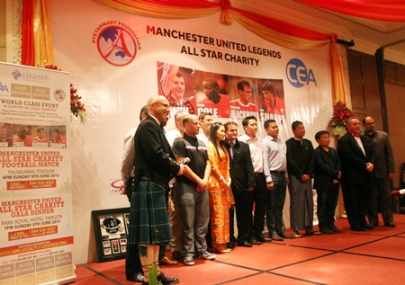 The Manchester United players on stage with sponsors and organizers during the Myanmar leg of their trip where over 30,000 US dollars were raised for charity.