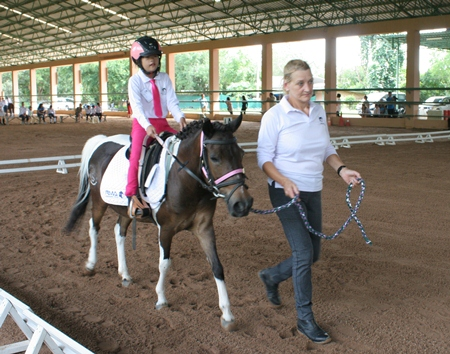 During the Walk Tests, the rider maybe led, and have a side walker.