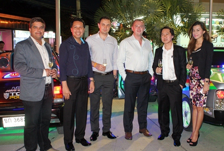 (From left) Suwanthep Malhotra (Asst. MD Pattaya Mail), Sompat Jantawan (GM of Tsix5 Hotel), Dimitri Chernyshev (Exec. Asst. Manager Pullman Pattaya Hotel G), Garth Solly (GM Holiday Inn Pattaya), and Sophon Vongchatchainont (GM Pullman Pattaya Hotel G) share the spotlight with the tricked out cars in the background.
