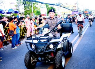 Pol. Lt. Col. Arun Promphan, Pattaya's Tourist Police commander, leads a patrol team on bicycles in the 6th Eastern Fair parade.