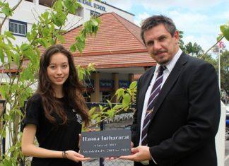 GIS Principal Dr Stuart Tasker presents Hannah with a special plaque.