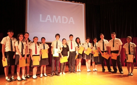 LAMDA students proudly display their certificates.