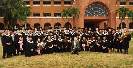 All sixty graduates with the school principal, Mike Walton.