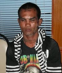 Seng Butngam has been brought in to face murder charges for his role in a jailhouse murder.