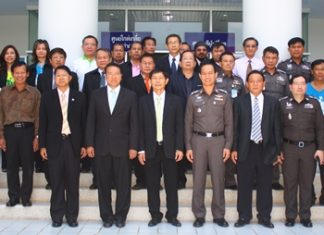 Pattaya Court Chief Justice Apichart Thepnu (front row, 2nd left), , Director-General Pornsak Thepasuwan (front row, 3rd left), Pol. Gen. Maj. Khatcha Thatsart (front row 4th right), and Prosecutor Sitthipol Photchai (front row 3rd right), pose with other honored guests during the 13th founders day activities at Pattaya's Courthouse.