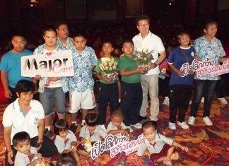 Thanakorn Pulilaekin (center, white shirt), film administrator for Major Cineplex Group, unveiled the Major Care Foundation initiative May 23 at The Avenue galleria theater.