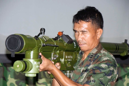A Royal Thai naval officer demonstrates how to hold the new weapon when preparing to fire.