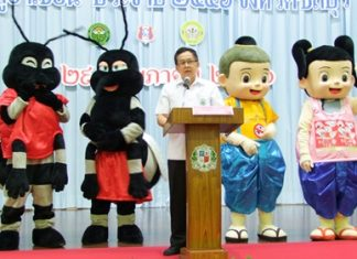 Dr. Pornthep Siriwanarangsun, with help from a quartet of mascots, teaches students at Assumption School how to avoid getting dengue fever and how to get rid of mosquitoes.