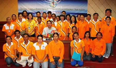 Pattaya Environment Office staff gather around Mayor Itthiphol Kunplome after the seminar.