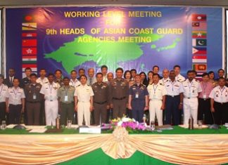 Delegates pose for a group photo during this summit of Coast Guard agencies from 19 countries.
