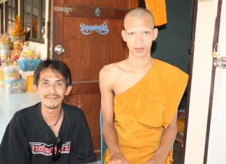 Novice monk Khajornwat Chanuthattmumophikhu (right) won 6 million baht in the government lottery. He promised not to spend the money until after he defrocks on July 1.