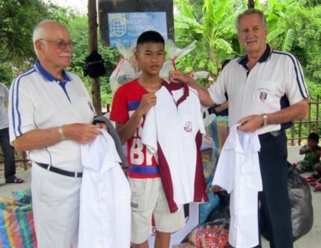 The older children receive their uniforms.