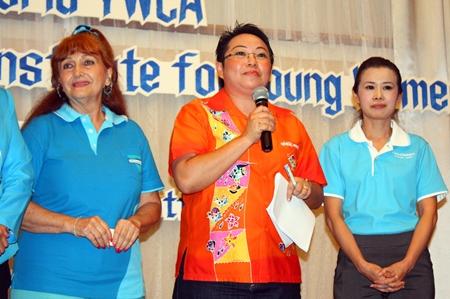 Janjira Thaibunthit (center) welcomes everyone to the event, whilst YWCA President Praichit Jetpai (right) and Pattaya Blatt's Elfi Seitz listen in.