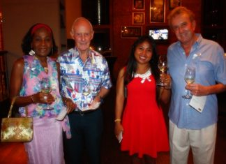(L to R) Janet and Richard Smith, Jan and Jim Benson sample the best wine on offer.