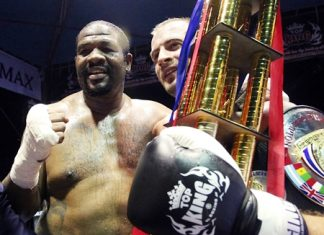 Former heavyweight boxing champion Riddick Bowe of the U.S. (left) congratulates champion Levgen Golovin (right) after the Russian halted Bowe's challenge in their World Muay Thai Super-Heavyweight Championship fight at Pattaya's Bali Hai Pier, Friday, June 14. Bowe's much vaunted ring comeback lasted barely 5 minutes before he was sent to the canvass and counted out following a kick from Golovin in the second round of the contest. (AP Photo/Apichart Weerawong)