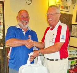 Dick Warberg (right) presents the MBMG Group Golfer Of The Month award to Max Bracegirdle.