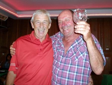 Terry Mangan (left) congratulates golfer of the month JJ Mafray.