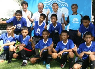 The boys from the Father Ray Children's Home and Father Peter (second right) pose with officials from the Chang-Everton Football Academy.