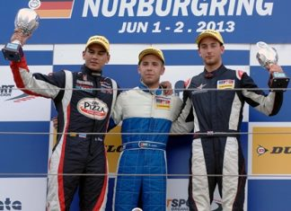Sandy Stuvik (left) stands on the podium with Ed Jones (center) and Hector Hurst (right) after Race 1 at the Nürburgring in Germany, Saturday, June 1.