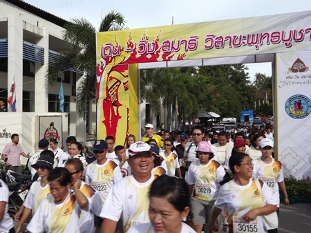 Runners and walkers get underway at the walk-run marathon for Visakha Bucha Day on Pratamnak Hill, Friday, May 24.