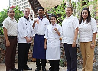 Andre Brulhart (2nd right), Area General Manager of Centara Grand Mirage Beach Resort Pattaya, congratulates Prawit Sangkheet (3rd left) and Jamnong Sessathit (3rd right), two of the resort's kitchen staff who earned two awards at the Thailand Ultimate Chef Challenge 2013 (THAIFEX - World Food Asia) held at IMPACT Muang Thong Thani recently. Prawit won a bronze medal at the Modern Thai cuisine competition, and Jamnong a silver medal from the contest for four different Individual Western Plated Desserts. Also seen congratulating the two winners are Wuthisak Pichayagan (left), Executive Assistant Manager for Food and Beverage, Executive Chef Colin Grant (2nd left), and Daranat Nuchaikaew (right), Director of Human Resources.