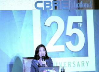 CBRE Thailand Managing Director, Aliwassa Pathnadabutr, talks during a press conference marking the company's 25 years of business in Thailand.