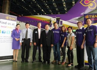 Danuj Bunnag (4th left), Executive Vice President, Product & Customer Services, Thai Airways International Public Company Limited (THAI), recently welcomed a group of social media and Facebook Fanpage members on a tour of THAI's new Boeing 777-300ER aircraft at THAI's Technical Department, Suvarnabhumi Airport. Mrs. Sunathee Isvarphornchai (3rd right), THAI Vice President, E-Customer Relations Department; Rangsiman Mokkhasmit (2nd left), and Kent D. Craver (3rd left), Regional Director, Cabin Experience & Revenue Analysis Marketing, Boeing, were also present. THAI's Boeing 777-300ER aircraft is used on flights to Seoul, Shanghai, Copenhagen and Los Angeles.