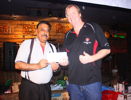 Peter presents a raffle prize gift voucher to Executive editor Dan Dorothy.