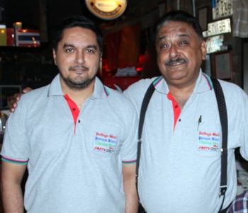 Son Prince Malhotra (left) poses for a photo with his proud father Peter.